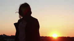 Beautiful woman dancing in sunset, silhouette of drunk female moving to music Stock Footage