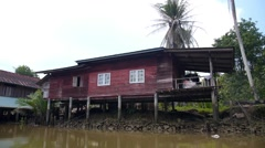 Poor Slum Houses on River in Thailand Stock Footage