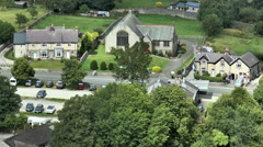 Elevated close view of scenic Peak District village. - stock footage