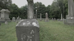 Graveyard Dolly Shot, Headstones with Surrounding Forest Stock Footage
