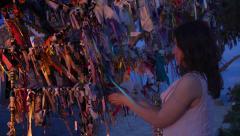 Stock Video Footage of Beautiful bride ties ribbon on wish tree, wedding ceremony, symbolic tradition