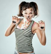 Girl painted like a cat, the picture is  joke. Stock Photos