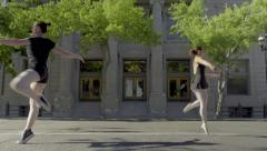Two Ballet Dancers Pirouette Across Frame, Coming From Opposite Directions (4K) Stock Footage