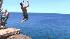 Incredible Hawaiian Cliff Jump Stock Footage