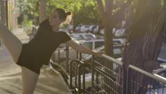 Young Woman Uses Railing In Front Of Shops To Practice Dance Moves (Slow Motion) Stock Footage