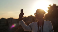 Happy girl on vacations taking self photo under the sunset, slow motion HD Stock Footage