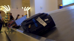 Baggage on Conveyor Belt of Airport Stock Footage