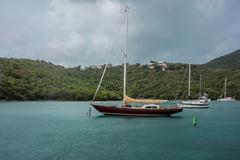 Sailboat Docked in Maho Bay Stock Photos