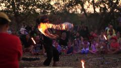 Firedancer entertaining a crowd - stock footage