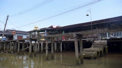 Fisherman Village on Water with Long Tail Boat. Asian Slums Stock Footage