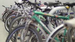Bicycles are standing in a row. Close-up, rack focus 4K Stock Video Stock Footage