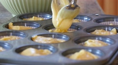 A woman makes cupcakes in kitchen Stock Footage