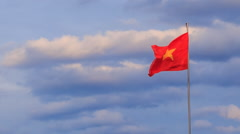 View of Vietnamese banner flapping in wind at sunrise Stock Footage