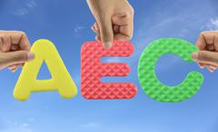 Hand arrange alphabet AEC of acronym ASEAN Economic Community. Stock Photos