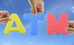 Hand arrange alphabet ATM of acronym Automatic Teller Machine. Stock Photos