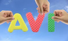 Hand arrange alphabet AVI of acronym Audio Video Interleave. Stock Photos