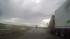 Passing two semi trucks in rain on I-70 - stock footage
