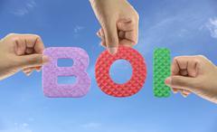Hand arrange alphabet BOI of acronym Board of Investment of Thailand. - stock photo