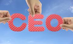 Hand arrange alphabet CEO of acronym Chief Executive Officer. - stock photo