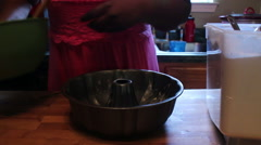 Pouring Batter in pan Stock Footage