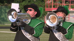 Marching bands drums corps and crowds on university college football field Stock Footage