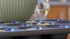 A woman makes cupcakes Stock Footage