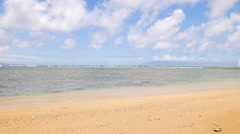 Pan of Hawaiian beach during bright day Stock Footage