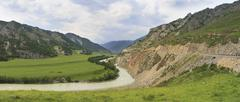 Bending of Chuya River and Chuysky Trakt in Altai Mountains - stock photo