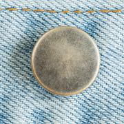 Old metal button of jeans fashion Stock Photos