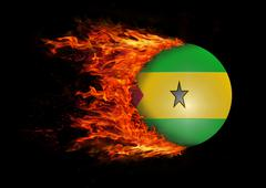 Flag with a trail of fire - Sao Tome and  Principe - stock photo