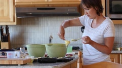 A woman making cupcakes in the kitchen Stock Footage