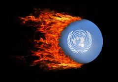 Flag with a trail of fire - United Nations - stock photo