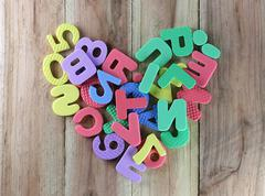 The numbers and letters arranged in a shape heart. - stock photo