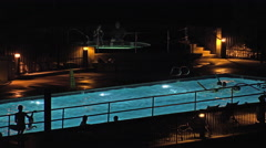 Resort night Silhouette swimming pool play dark 4K Arkistovideo