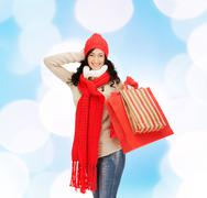 smiling woman in warm clothers with shopping bags - stock photo