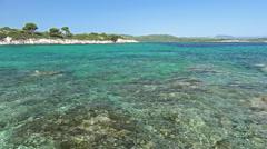 Waves splashing rocks in turquoise water Brac Island - Croatia Stock Footage
