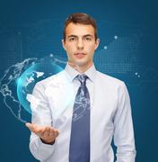 Man holding virtual sphere globe on the palm Stock Photos