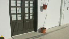 Vertical panorama of wooden doors in private house. Quiet resort town off season - stock footage