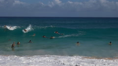 Swimming and surfing at sandy beach, hawaii Stock Footage