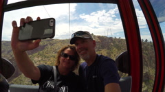 Couple on a gondola at Royal Gorge taking a selfie Stock Footage