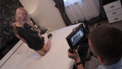A girl model posing on the bed Stock Footage