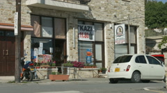 Street view in little mountain village, Cyprus. Grocery store. Vacation, tourism Stock Footage