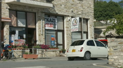 Vertical panorama of masonry building with small convenience store, street view - stock footage