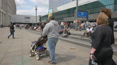 Sitting on the stairs in Alexanderplatz, Berlin Stock Footage