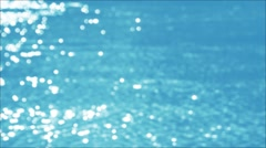 Flecks of sunlight sparkle in fast moving water current. Stock Footage