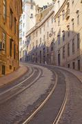 Street with tramway rails in Lisbon, Portugal - stock photo