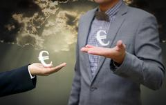 Businessman show euro money symbol in hand for agreement Stock Photos
