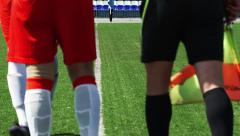 Soccer player and linesman are waiting a change Stock Footage