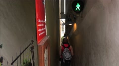 Tourists on the Prague's Narrowest Street  with the pedestrian Traffic Light. Stock Footage