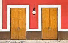 Two doors against color wall Stock Photos